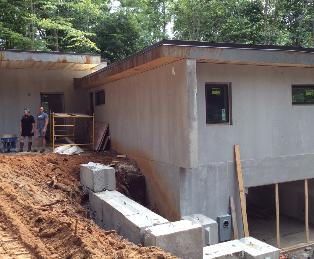 Earthtone builders brutalist modern home for Concrete construction homes